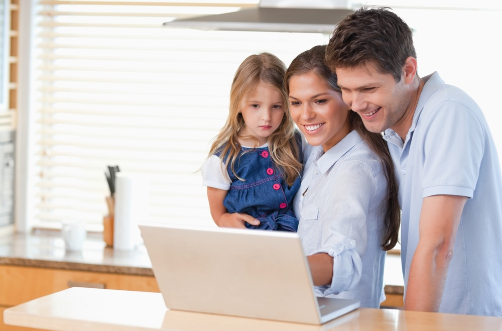 Family using a laptop in a kitchen.jpeg