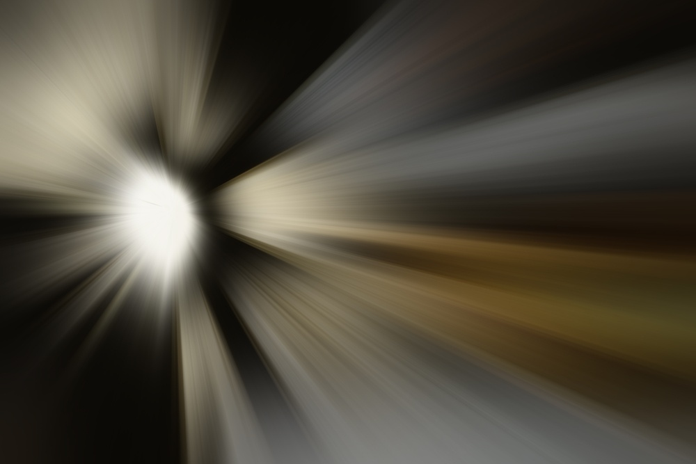 Radial blur of a mysterious source of light beams such as stellar formation or explosion.jpeg