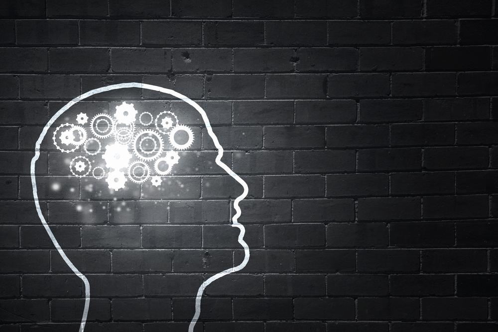 Silhouette of human head with gears mechanism instead of brain